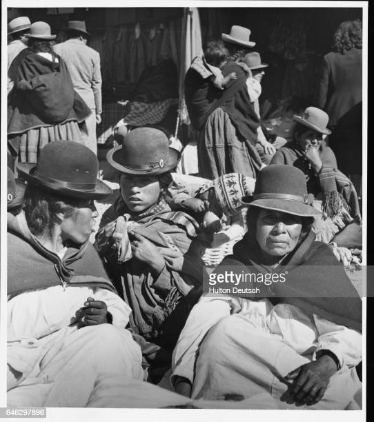 Mothers and their babies sit amid the throng gathered at the Bolivian town for market day