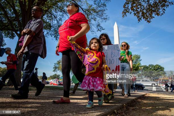 Mothers and their children with Moms Clean Air Force walk to meet up with other protesters for the Global Climate Strike protests on September 20...