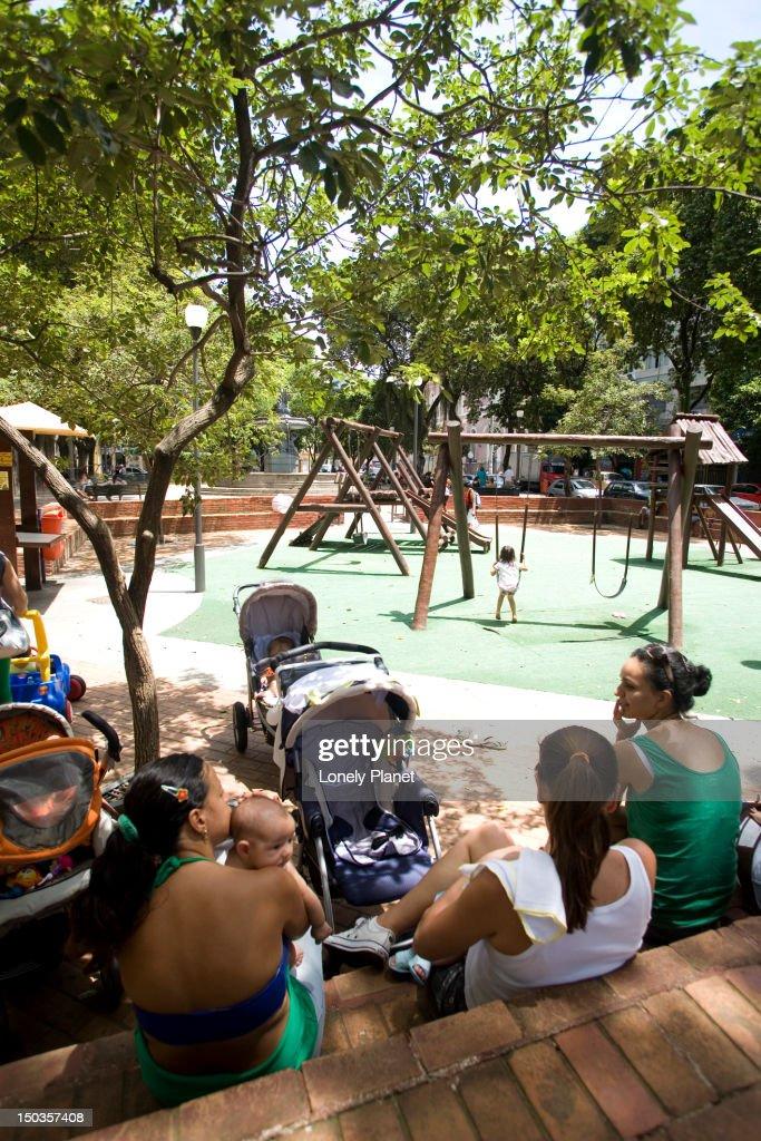 Mothers at playground of Praca Sao Salvador in the Flamengo and Laranjeiras neighborhoods. : Stock Photo