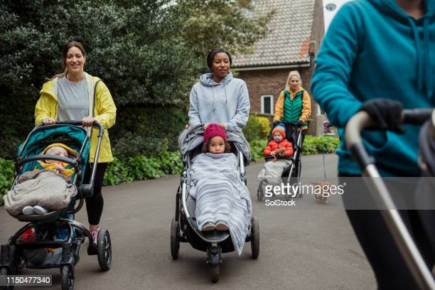 mothers bonding through exercise - carriage stock pictures, royalty-free photos & images