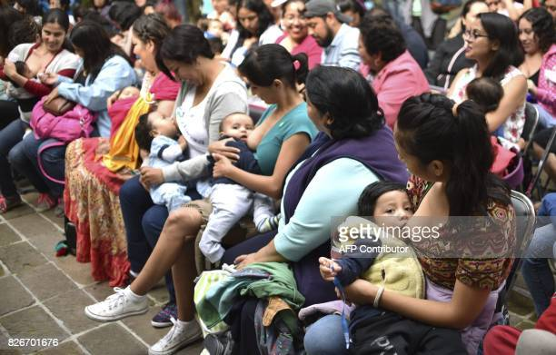 Mothers breastfeed their children during the Big Latch On breastfeeding festival held at the Bonatic Garden of the Chapultepec Park in Mexico City on...