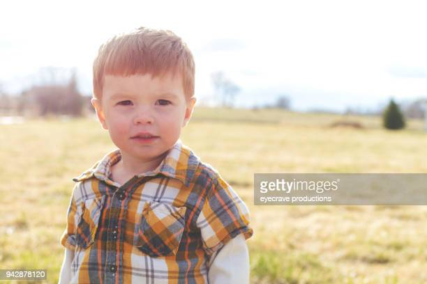 mother's day - expressive boy playing outdoors late evening in western colorado - eyecrave stock pictures, royalty-free photos & images