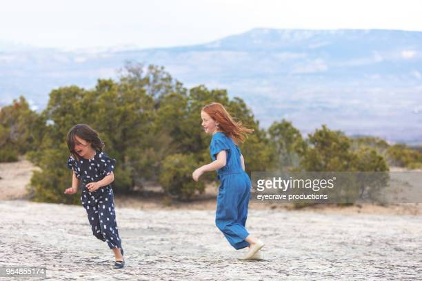 mother's day - young girls playing outdoors late evening in colorado west - kids playing tag stock photos and pictures