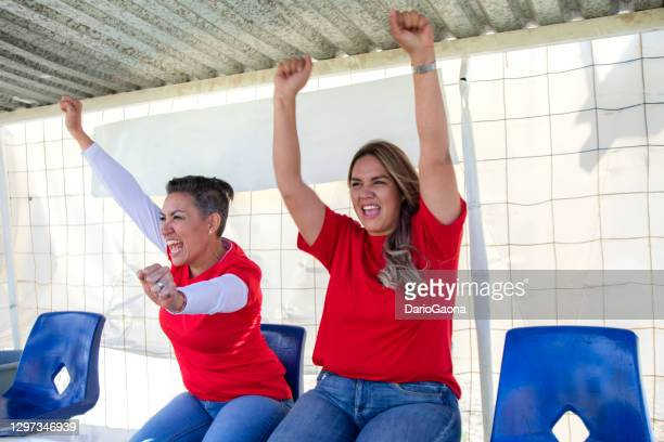mothers encouraging daughters in the stands - truncheon stock pictures, royalty-free photos & images