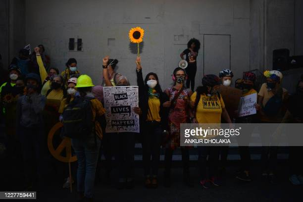Mothers form a human chain during a protest in front of the Multnomah County Justice Center in Portland, Oregon, on July 23, 2020. - Police fired...
