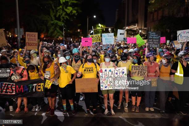 Mothers form the front line of a protest march toward Mark O Hatfield US Courthouse on July 20 2020 in Portland Oregon Monday night marked 54 days of...