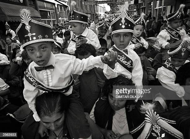Mothers from Bulgaria's ethnicTurkish minority carry their young boys before a mass circumcision ceremony in the mosque of Kardjali Bulgaria 04...