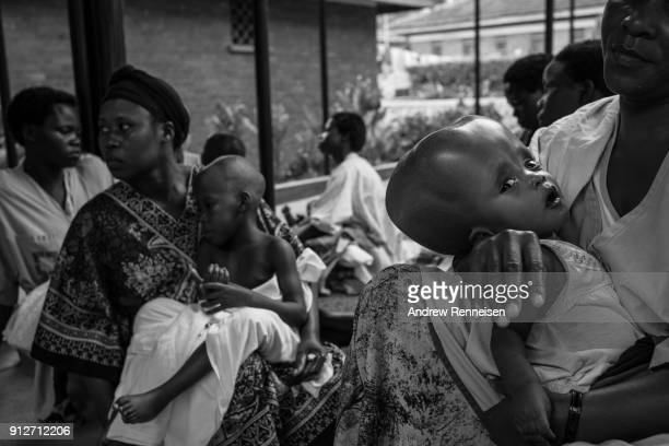 Mothers gather with their children on the compound of Cure Hospital on February 4 2017 in Mbale Uganda Some mothers are repeat visitors to this...