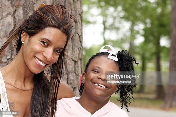 mother's love of her special needs daughter. - down syndrome stock pictures, royalty-free photos & images