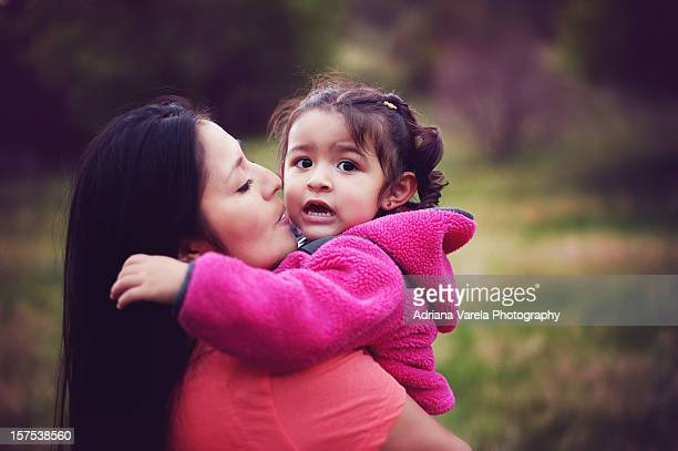 a mothers love - indian girl kissing stock photos and pictures