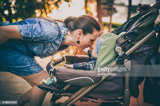 mother's love - pushchair stock pictures, royalty-free photos & images