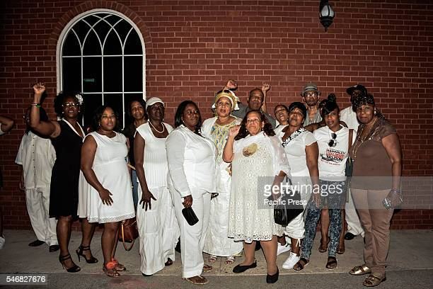 Mothers of children killed by police officers pose for a group portrait at Delrawn Small Dempsey's Funeral at Harmony Funeral Home 2200 Clarendon Road