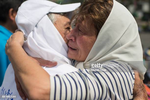 Mothers of disappeared embrace during a march on Mother's Day on May 10 2017 in Mexico City Mexico Mothers whose children are missing during the war...