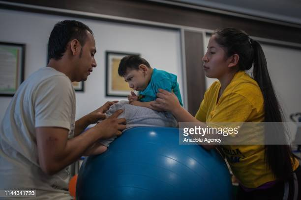 Mothers of the Association Miracles of God - Sons of Zika perform neurological exercises for children with microcephaly in Neiva, Huila, Colombia on...