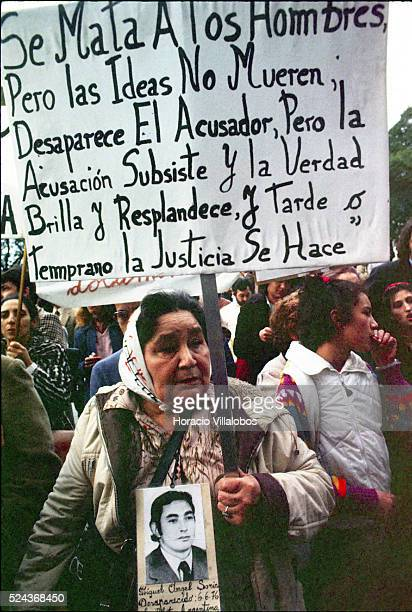 Mothers of those gone missing during Argentina's Dirty War stage a protest in Buenos Aires in 1983 This mother's sign reads Men are killed but not...