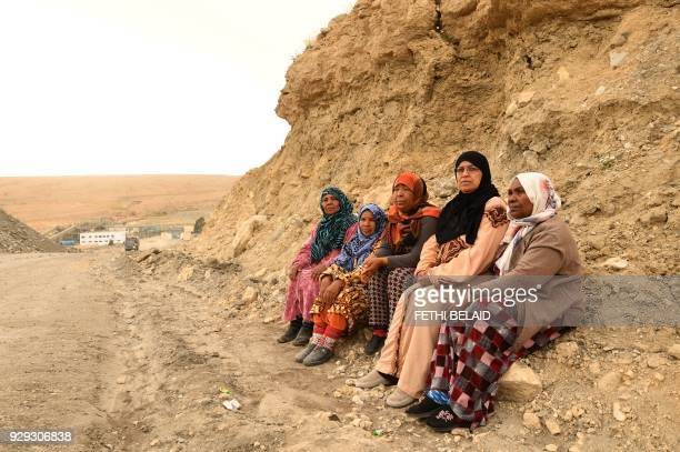 Mothers of unemployed Tunisian men sit at a phosphate production plant in Kef Eddour in the Metlaoui mining region one of the main mining sites in...
