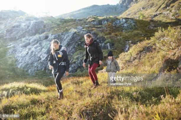 Mothers trekking with daughters in mountains