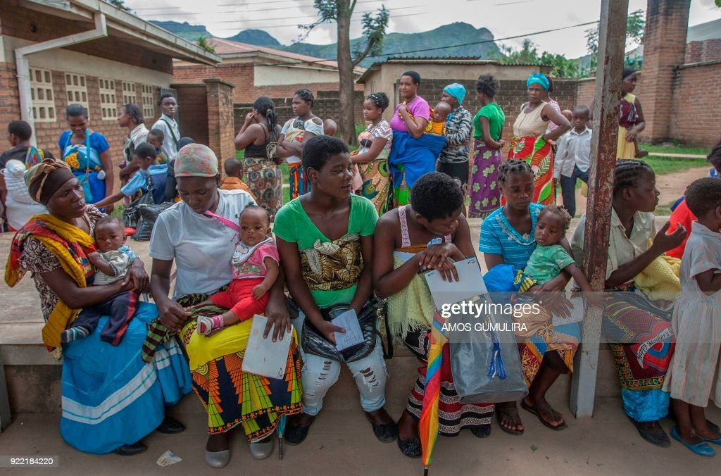 Mothers wait to be immunized from various diseases at Ndirande Health Centre in Blantyre on February 21, 2018., prior to the launch of a Typhoid Fever vaccination campaign by Malawi Liverpool Welcome Trust. Some 23000 children are being targetted for vaccination during the campaign period. / AFP PHOTO / Amos Gumulira