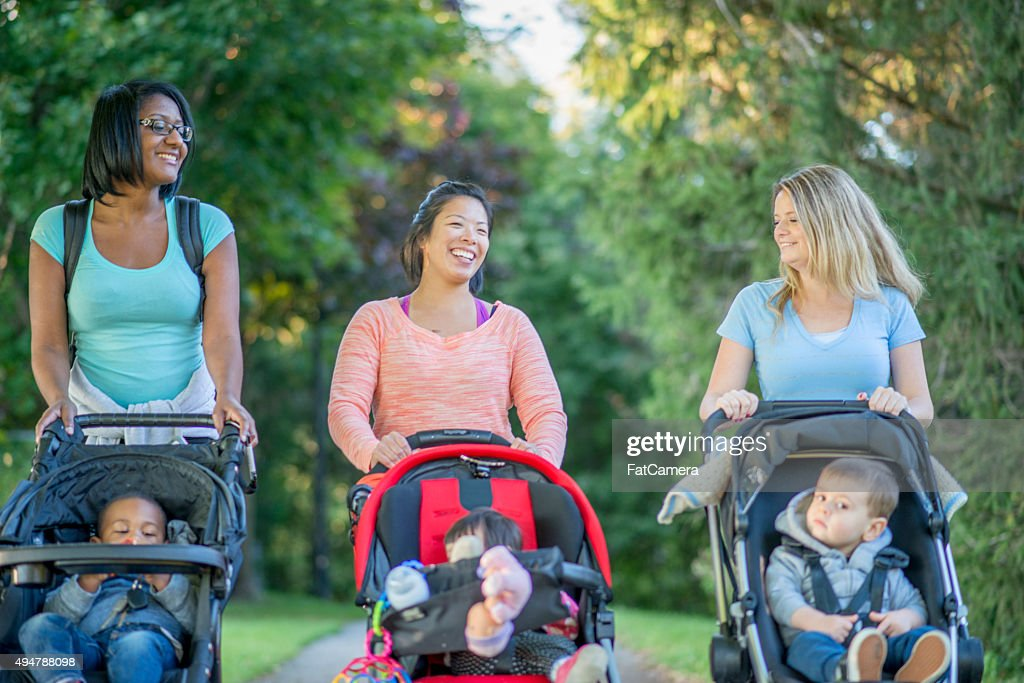 Mother's Walking with their Kids at the Park : Stock Photo