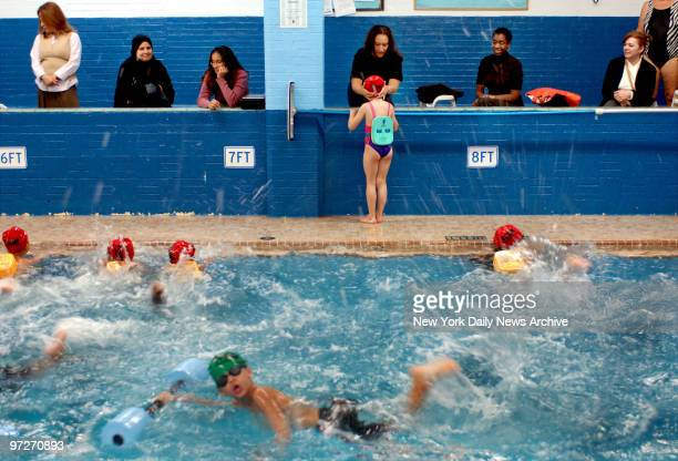 Mothers watch poolside as school children from PS 10 learn how to swim at the YMCA in Park Slope Brooklyn Sixteen YMCAs across the city are offering...