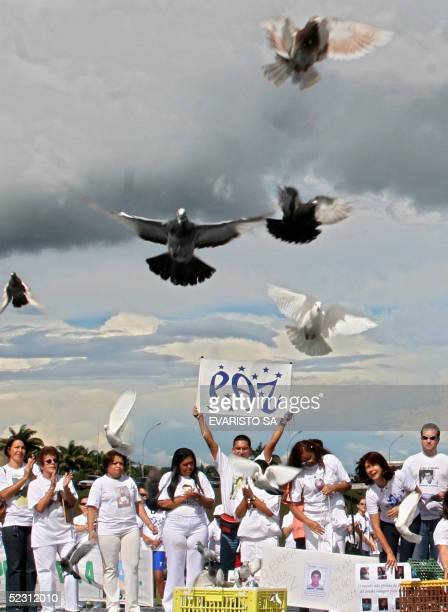 Mothers who lost their children due to violence release doves during a protest in front of the National Congress in Brasilia Brazil as part of the...