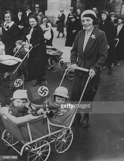 Mothers with their children in perambulators decorated with Nazi flags in Berlin Germany on April 8 1934