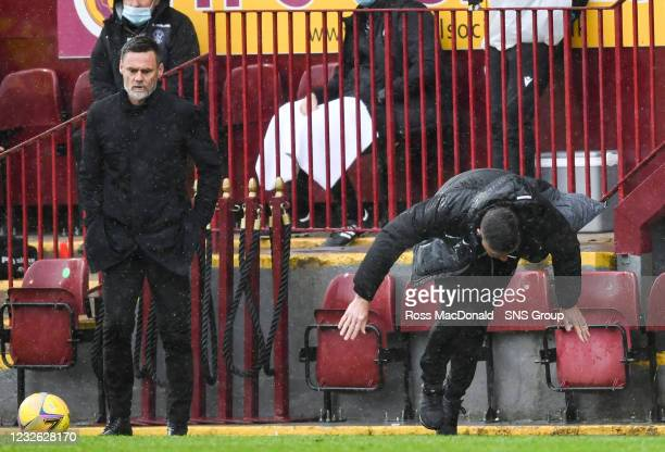 Motherwell assistant manager Chris Lucketti loses his footing during a Scottish Premiership match between Motherwell and Kilmarnock at Fir Park, on...