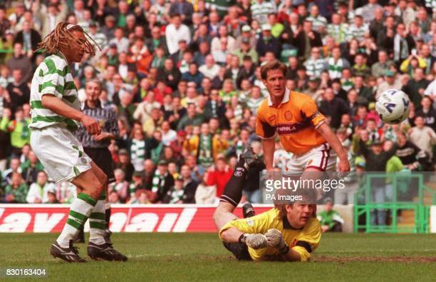 Motherwell keeper Andy Goram makes a point blank save from Celtic's Henrik Larsson in their Scottish Premier League football match