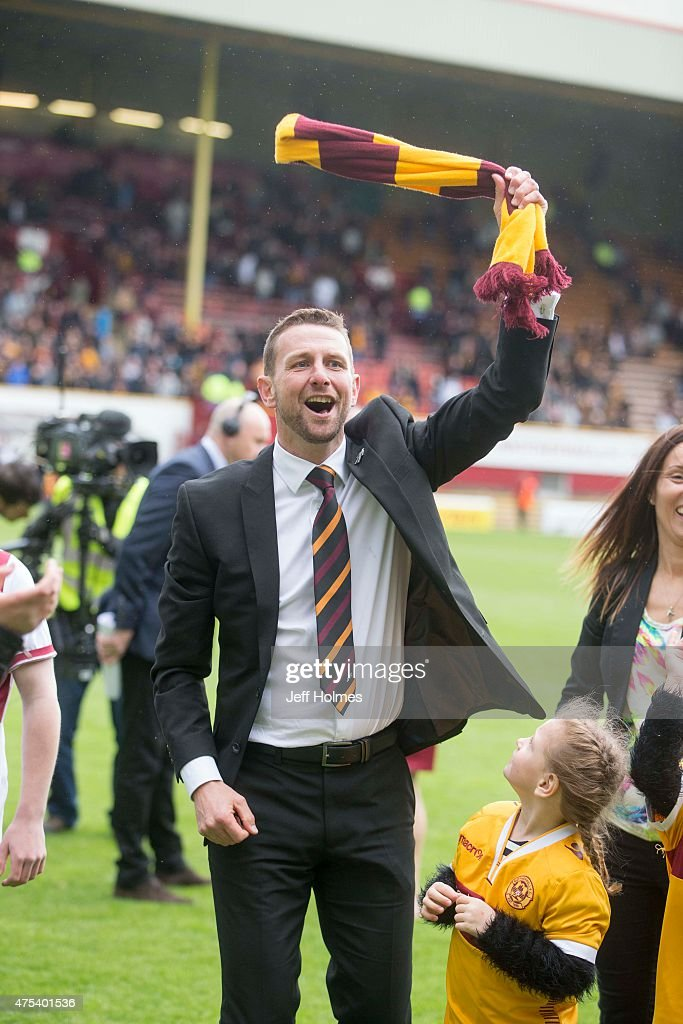 Motherwell manager Ian baraclough celebrates at the end of the Scottish Premiership play-off final 2nd leg between Motherwell and Rangers at Fir Park on May 31, 2015 in Motherwell, Scotland.