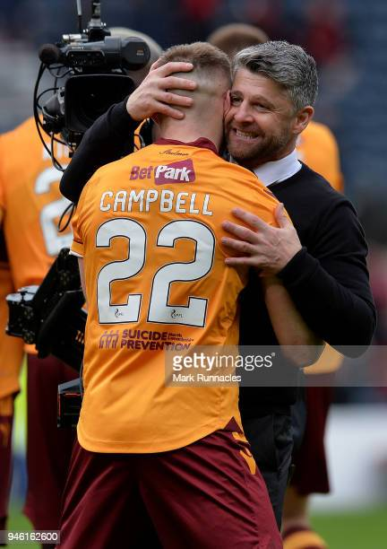 Motherwell manager Steve Robinson celebrates with Allen Campbell of Motherwell at the final whistle as Motherwell beat Aberdeen 30 during the...