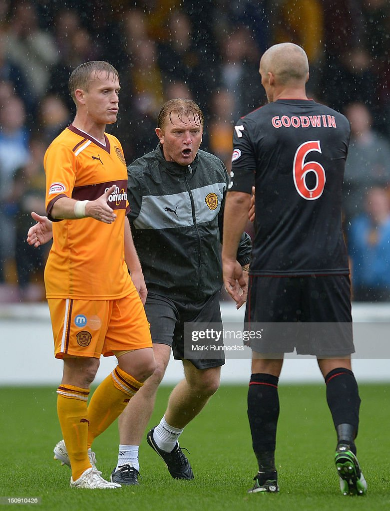 Motherwell manager Stuart McCall urges Stevie Hammell of Motherwell to leave the pitch at the end of the SPL match between Motherwell and St Mirren at Fir Park on August 26, 2012 in Motherwell, Scotland.
