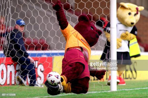 Motherwell mascot Claret Bear makes a great save from a penalty watched by Amber Bear