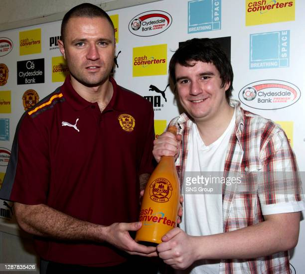 Michael Higdon is presented with Motherwell's Player of the Month award.