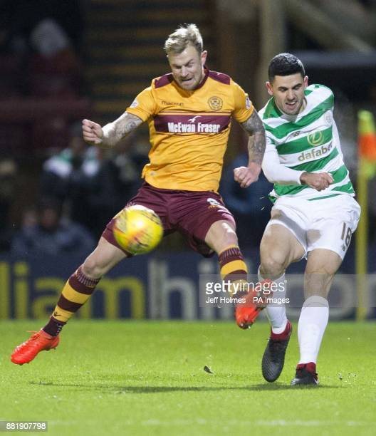 Motherwell's Richard Tait and Celtic's Tom Rogic during the Ladbrokes Scottish Premiership match at Fir Park Motherwell