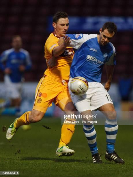 Motherwell's Robert McHugh tackles St Johnstone's David McCracken during the Clydesdale Bank Scottish Premier League match at Fir Park Motherwell