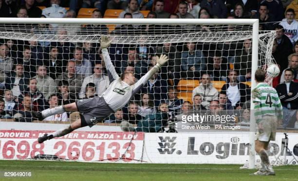 Motherwell's Scott McDonald's shot flys past Cetic goalkeeper Rab Douglas
