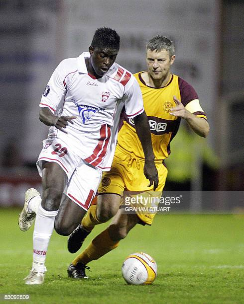 Motherwell's Stephen Craigan fights for the ball with AS Nancy's Alfred D'Diaye during their UEFA Cup first round, second leg football match at Fir...