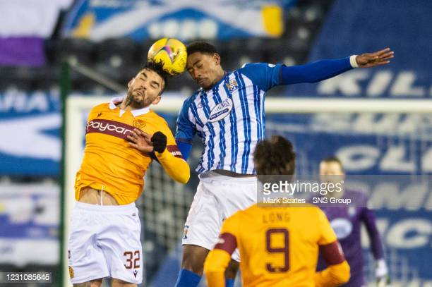 Motherwell's Tony Watt and Zech Medley of Kilmarnock compete for a header during a Scottish Premiership match between Kilmarnock and Motherwell at...