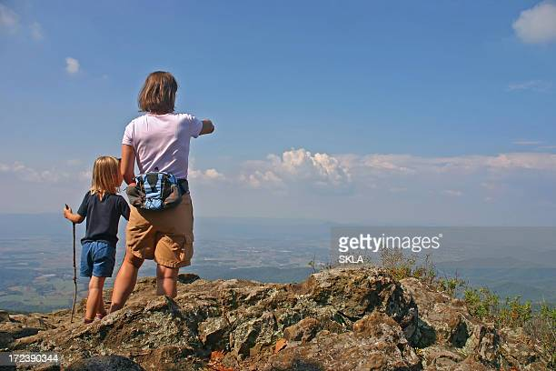 mother/women with young child hiking on top of the mountains - shenandoah_national_park stock pictures, royalty-free photos & images