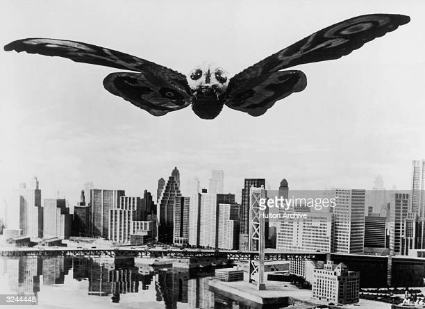 Mothra the giant moth soars menacingly over a Tokyo in a still from the Japanese film 'Mothra' directed by Ishiro Honda