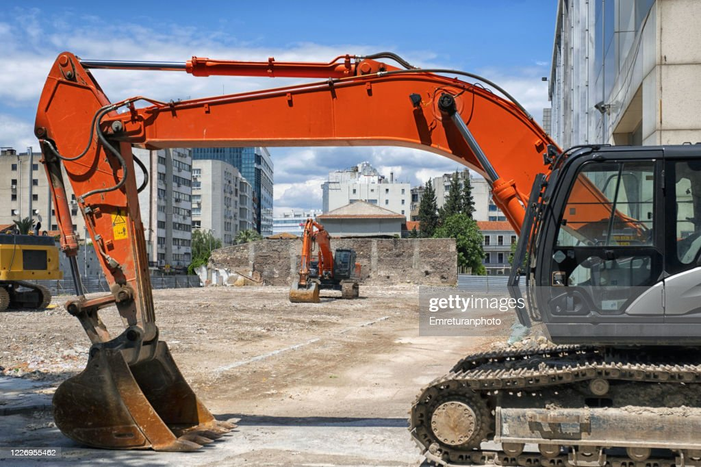 Motinless excavators on a sunny day standing in a construction site . : Stock Photo
