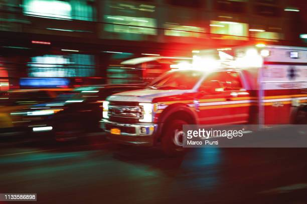 motion blur ambulance united states - emergencies and disasters stock pictures, royalty-free photos & images