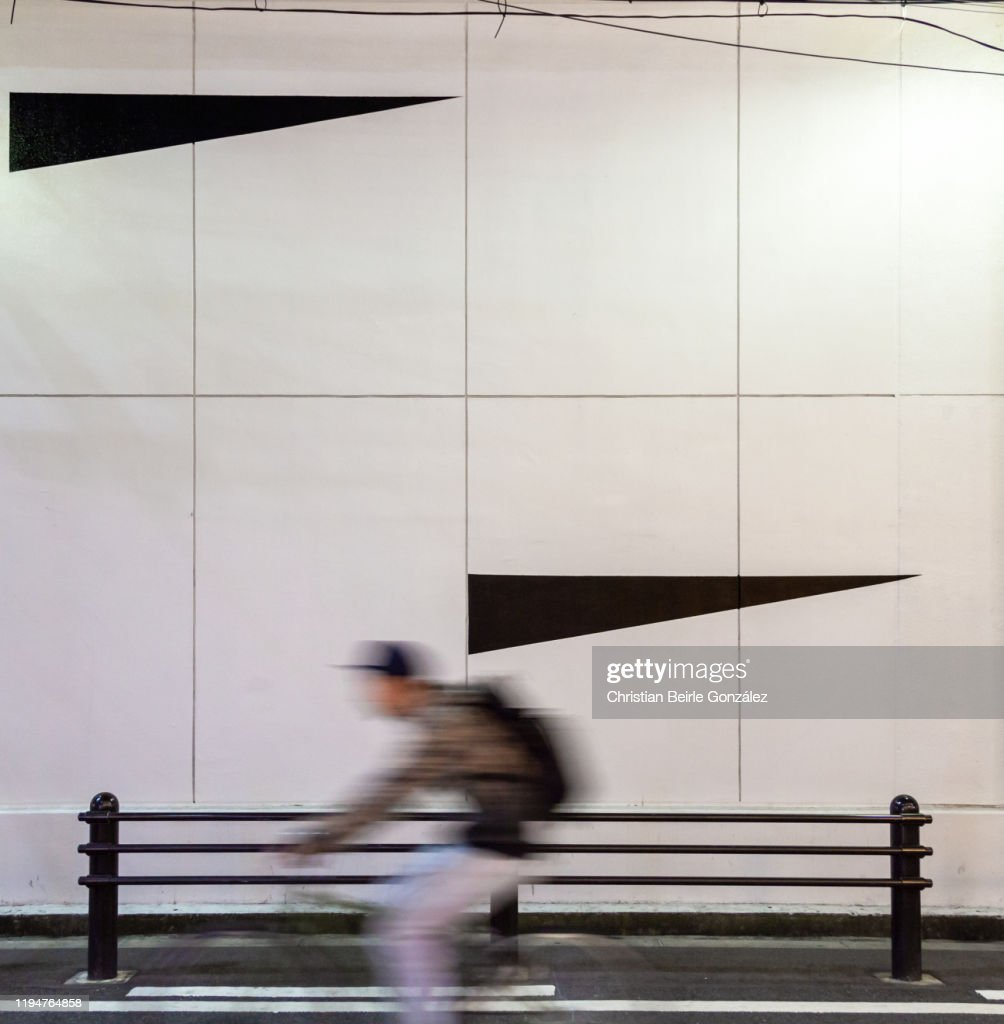 Motion blur of a male cyclist on street in Osaka, Japan : Stock-Foto