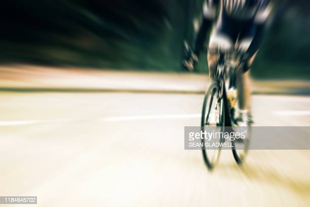 motion blur of cyclist - road race stock pictures, royalty-free photos & images