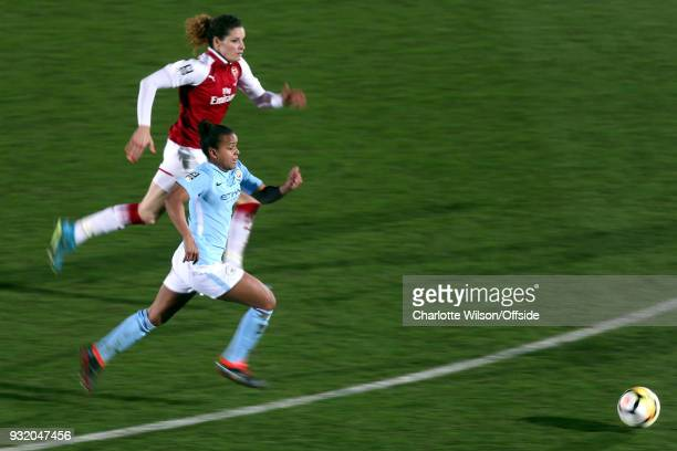 A motion blur of Dominique Janssen of Arsenal and Nikita Parris of Man City chasing down the ball during the WSL Continental Cup Final between...