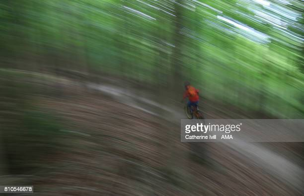 Motion blur of downhill mountain biking at Aston Hill on June 25 2017 in Aylesbury England