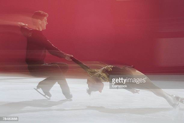motion blur of figure skating - figure skating stock pictures, royalty-free photos & images