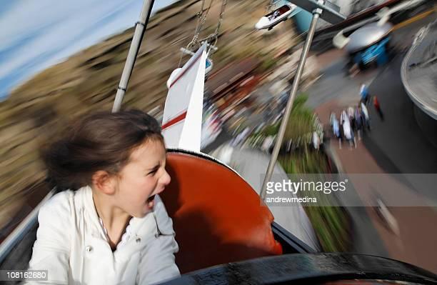 Motion Blur of Little Girl Riding Amusement Park Ride