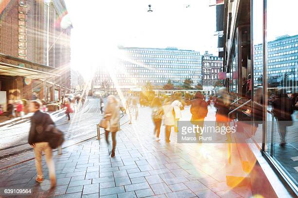 motion blur of people walking in the city - brightly lit stock pictures, royalty-free photos & images