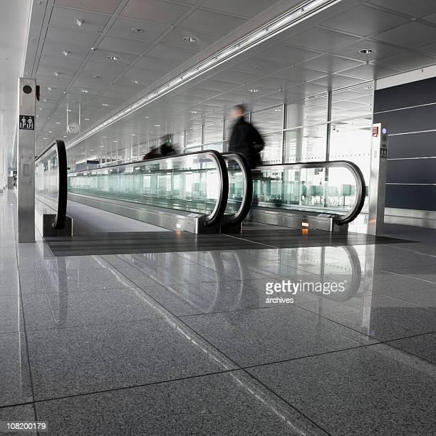 Motion Blur of People Walking on Moving Sidewalk at Airport
